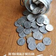 """jar of quarters on table - emergency fund - with text """"Create an emergency fund"""""""