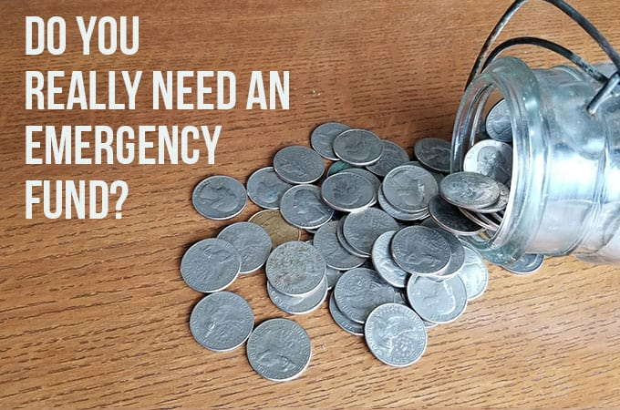 "jar of quarters on table - emergency fund - with text ""Create an emergency fund"""