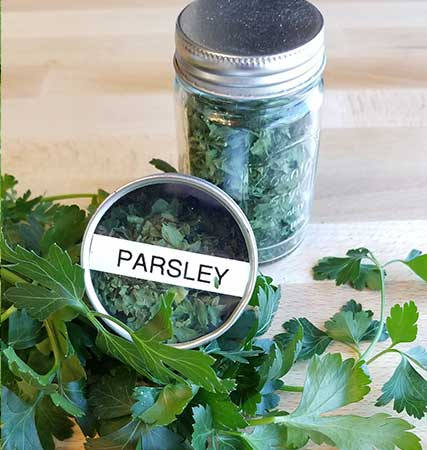 Dehydrated parsley stored in containers, dry parsley, dried herbs, save herbs