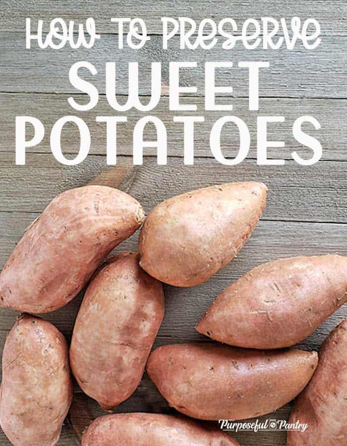 Whole sweet potatoes on a wooden backgroud
