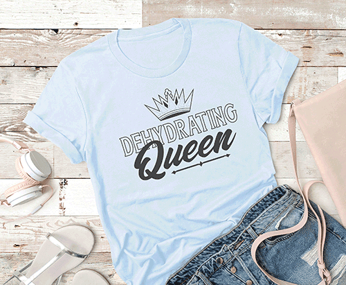 T-shirt mockup with white tshirt that says Dehydrating Queen laying on a shiplap background