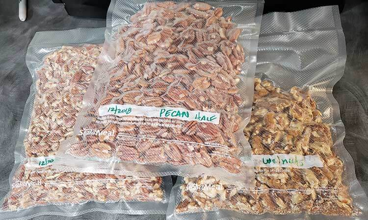 3 bags of bulk nuts witha food saver vacuum sealer for storing nuts