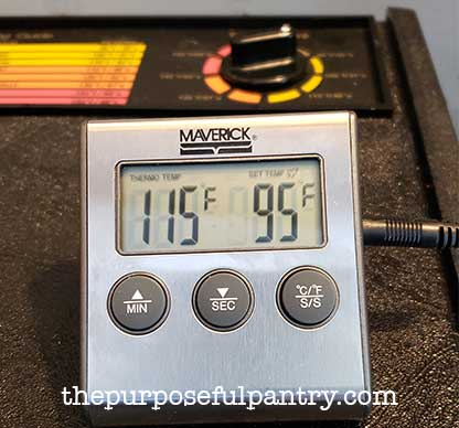 oven thermometer in open Excalibur Dehydrator to test dehydrator temperature