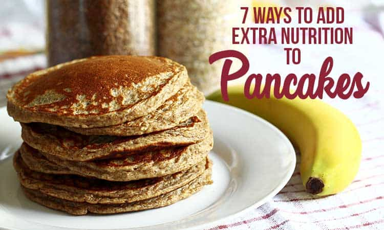 a stack of whole wheat pancakes on a white plate with a banana - for extra nutrition for pancakes