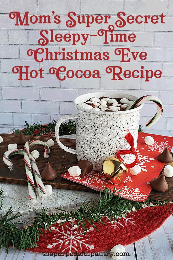 Mug full of hot cocoa, chocolate kisses, candycane