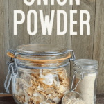 "A jar of dehydrated onions and DIY onion powder on wooden background with text, ""Make Your Own Onion Powder"""