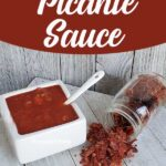 Square serving dish full of picante sauce and dehydrated picante sauce chips on wooden surface