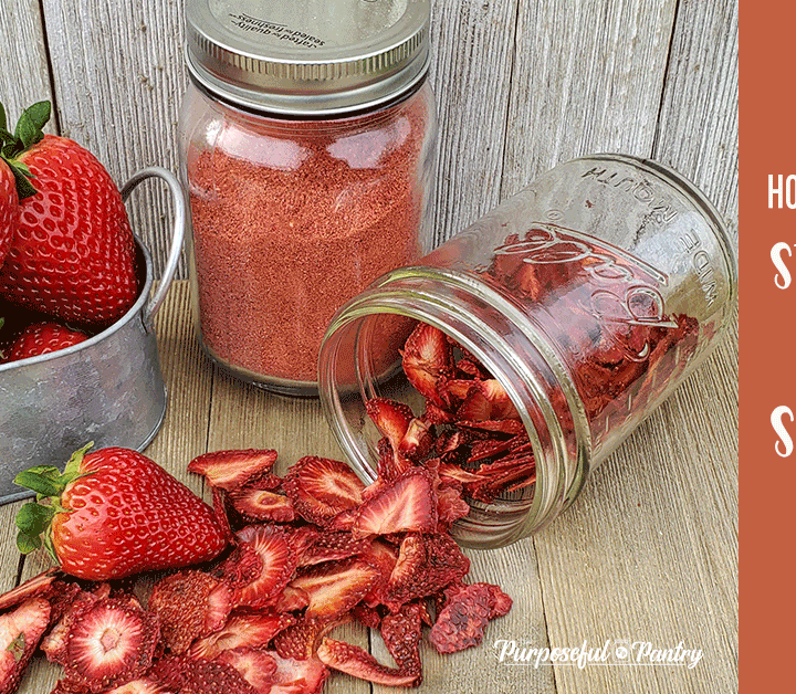 Strawberries and dried strawberries on a wooden background