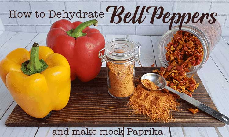 Bell peppers, paprika, and mason jar of spilled dehydrated bell pepper on wooden tray with metal spoon