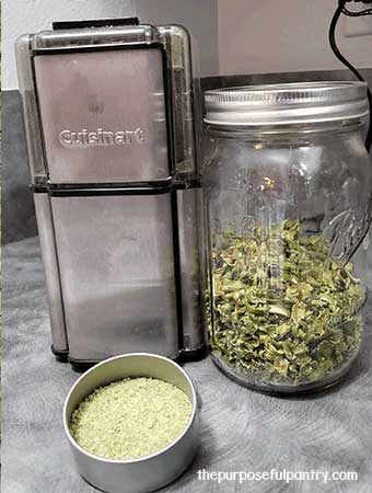 Cuisinart coffee grinder, mason jar of dehydrated celery and a container of celery powder
