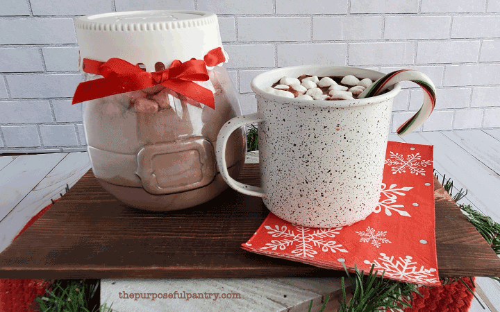 Hot cocoa in a mug wwith a gift jar of bulk hot cocoa mix
