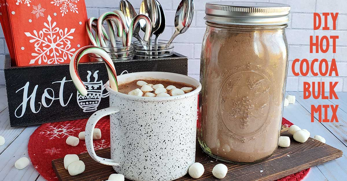Hot cocoa in a cup with a bulk hot cocoa mix in a mason jar