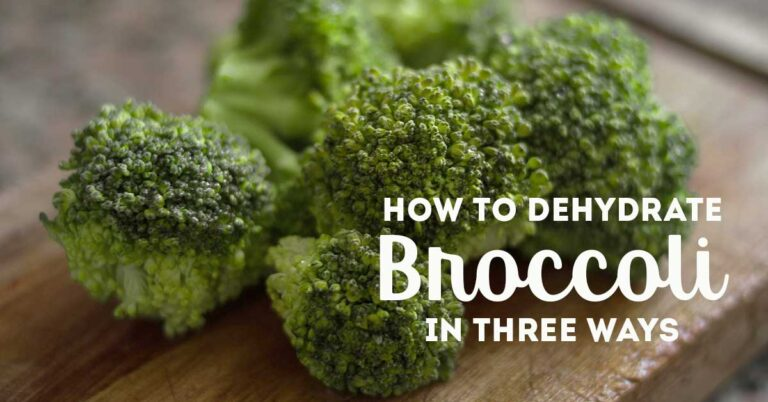 "Broccoli florets on wooden table with text overlay ""Dehydrate Broccoli three ways"""