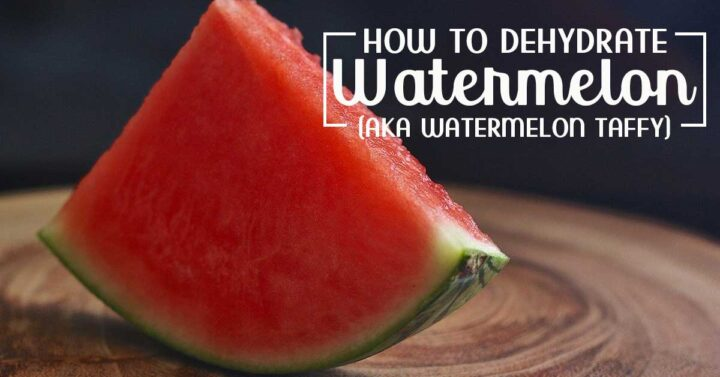 "Slice of watermelon on a wooden surface with text ovelray ""How to Dehydrate Watermelon"""
