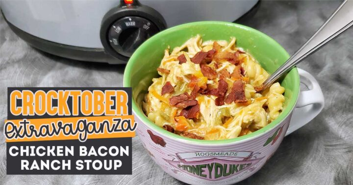 Chicken bacon ranch stew in large mug in front of slow cooker
