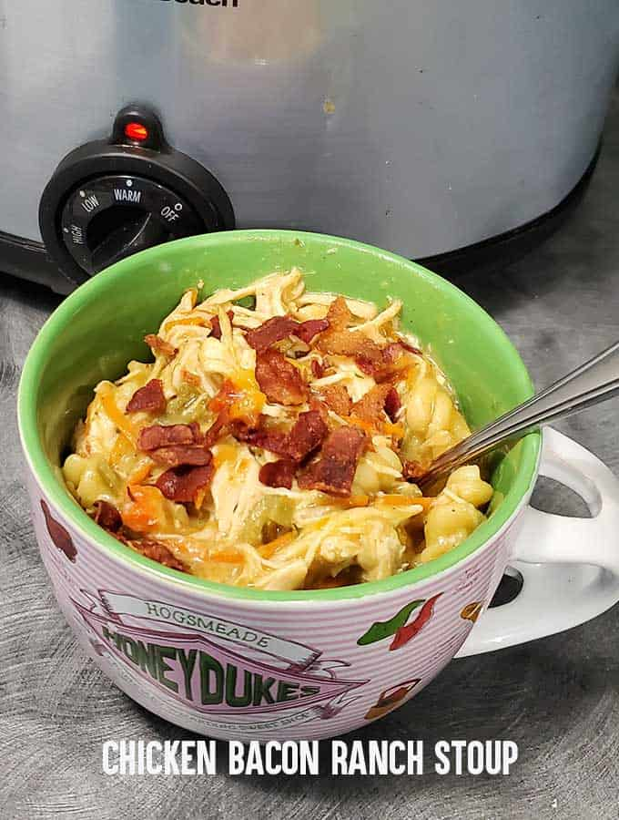 Chicken Bacon Ranch soup in a Honeydukes tea mug in front of a slow cooker