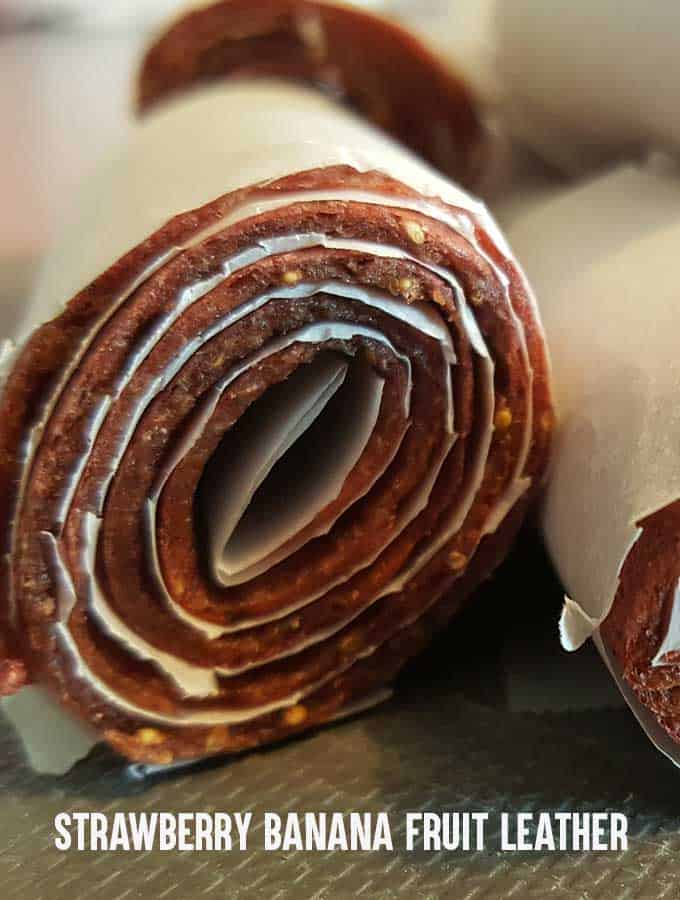 Strawberry banana fruit leather wrapped in parchment paper
