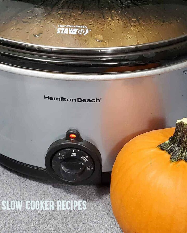 Slow cooker on the countertop with a pumpkin