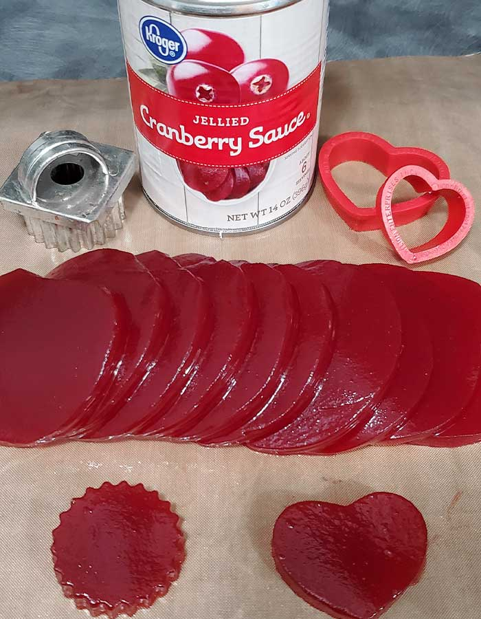 Cookie cutters, can of jellied cranberry sauce, and sliced sauce with a few cutouts