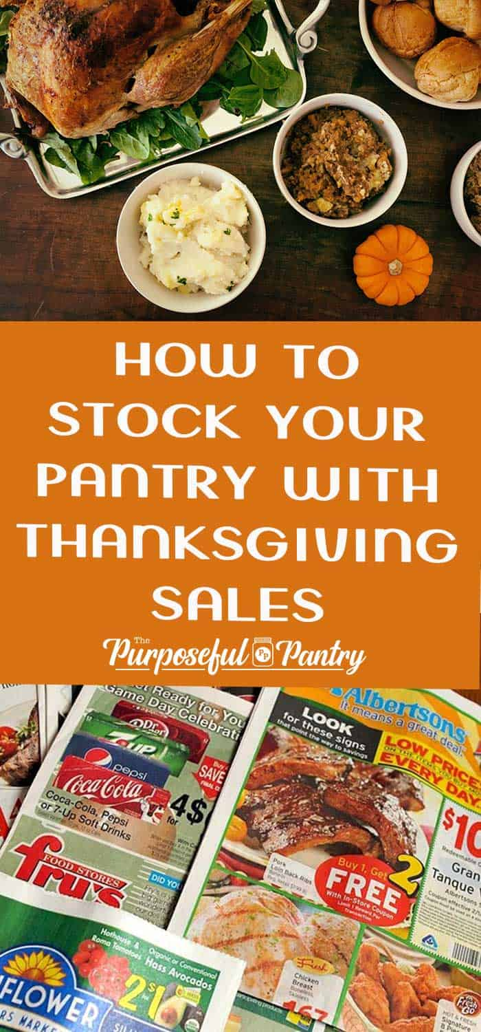 Thanksgiving feast on a table and sales circular from grocery stores
