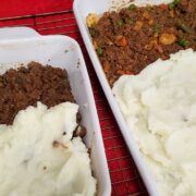 2 white baking dishes with cottage pie