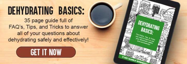 Dehydrating Basics ebook on a tablet with a cup of coffee on a wooden background