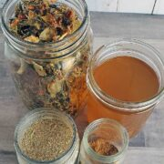 Jar of dehydrated vegetables, vegetable broth, dehydrated vegetable broth and vegetable powder on wooden background