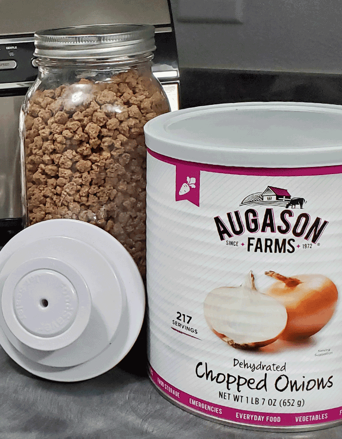large canning jar of freeze-dried ground beef, number 10 can of dehydrated onions.