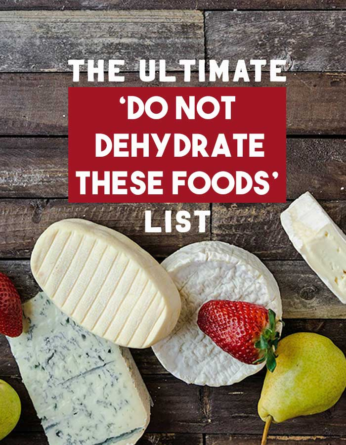 A wooden table filled with cheeses, strawberries and pears with text overlay The Ultimate Do Not Dehydrate These Foods list