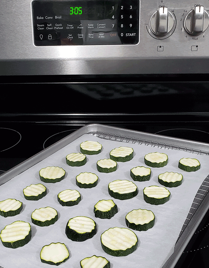 a rack of sliced zucchini on an oven to learn to dehydrate in the oven