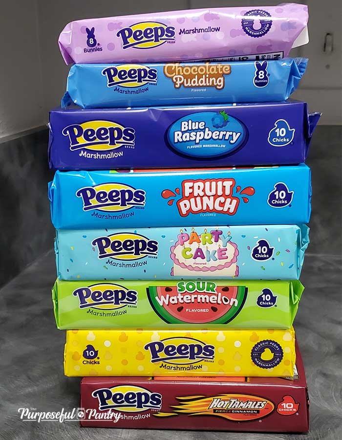 Packages of Marshmallow Peeps arranged in rainbow order being prepared to dehydrate them