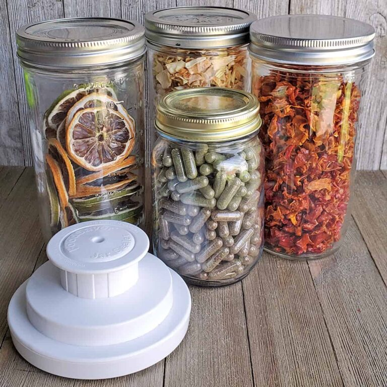 Dehydrated food in jars with a Foodsaver Vacuum Saler Jar Attachment on a wooden surface