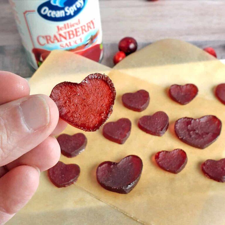 Heart-shaped cranberry sauce gummies (jellies) on parchment paper