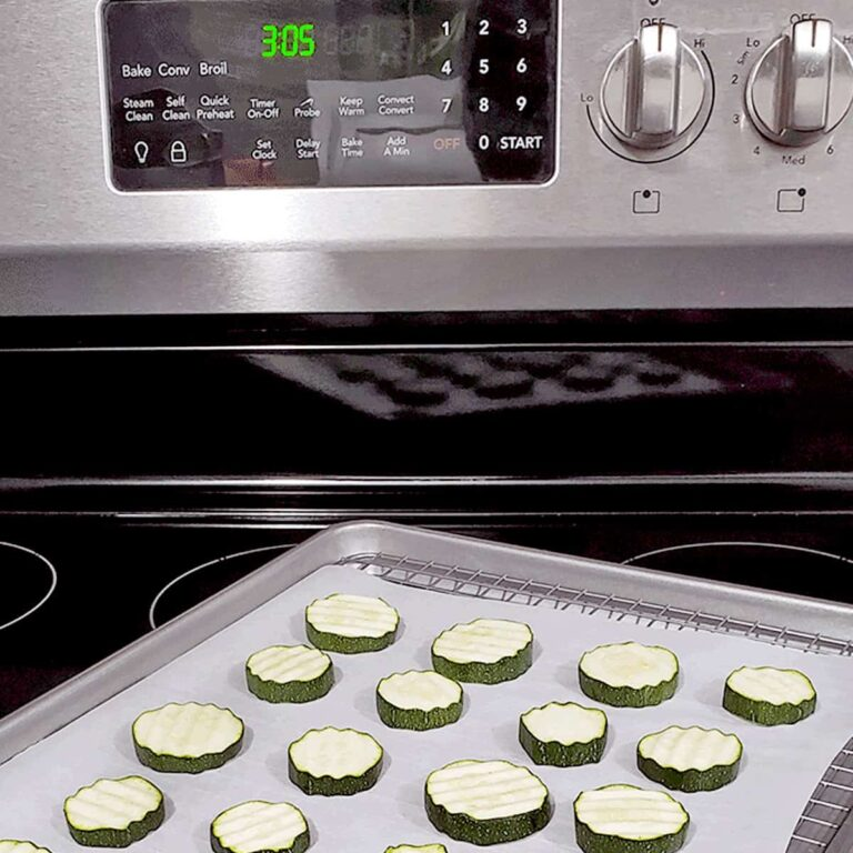 Frigidair oven with a tray of zucchini on it, ready to be dried in the oven