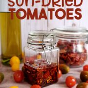 Jar of homemade sun-dried tomatoes with fresh tomatoes, olive oil and dried tomatoes