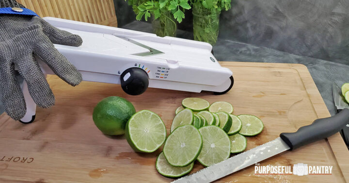 OXO Mandoline with protective glove and sliced lemons on a cutting board