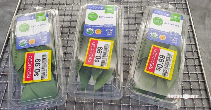 Bay leaves in plastic containers with reduced sales stickers from the grocery store