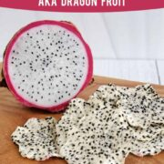 Fresh dragon fruit next to a pile of dehydrated dragon fruit (pitaya) chips on a wooden surface