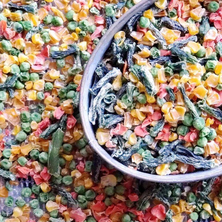 piles of dehydrated frozen vegetables in a bucket