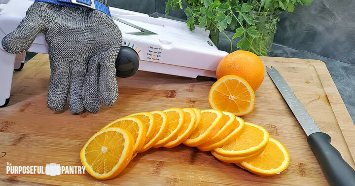Oranges cut in slices with an OXO mandoline preparing for dehydrating