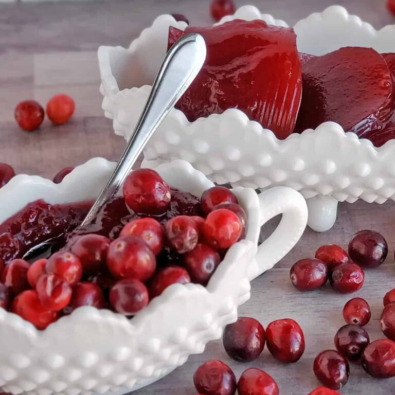 White milk glass serving dishes with cranberry sauce and jellied cranberry sauce