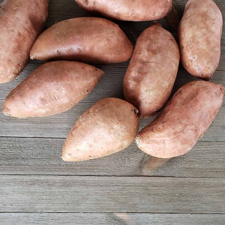 Sweet potatoes on a wooden surface