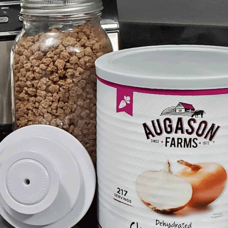 Jar of freeze dried ground beef, a foodsaver vacuum lid and #10 can of Augason Farms dehdyrated onion