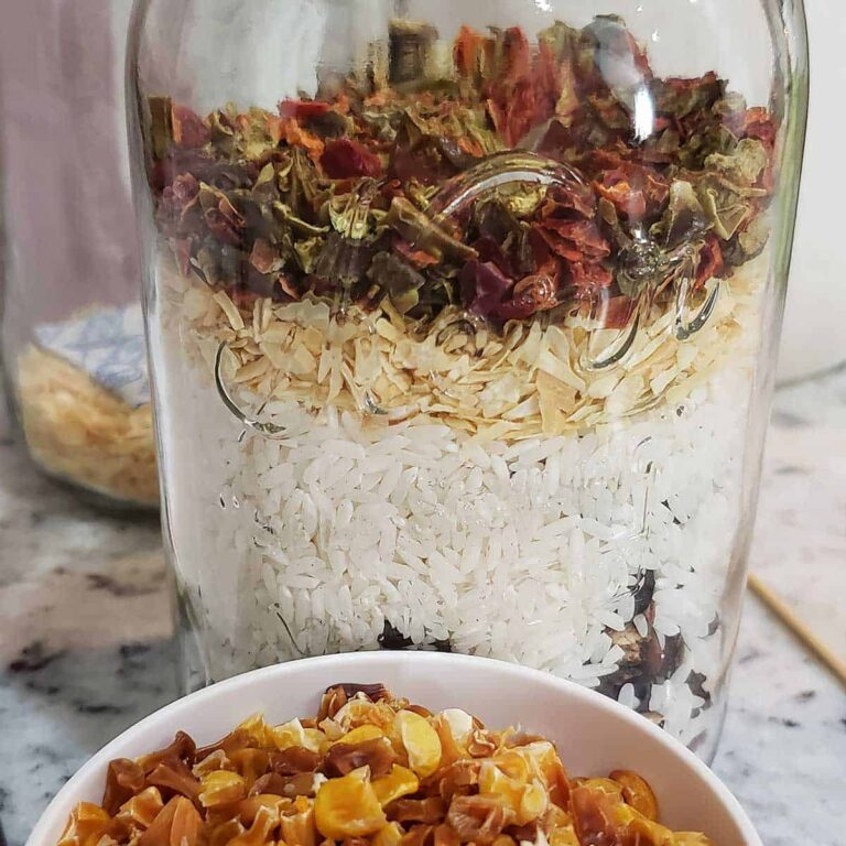 Taco soup ingredients layered in a canning jar for the a 'meal in the jar' pantry staple