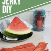 Watermelon slice on a blue plate with napkin and slices of dehydrated watermelon jerky