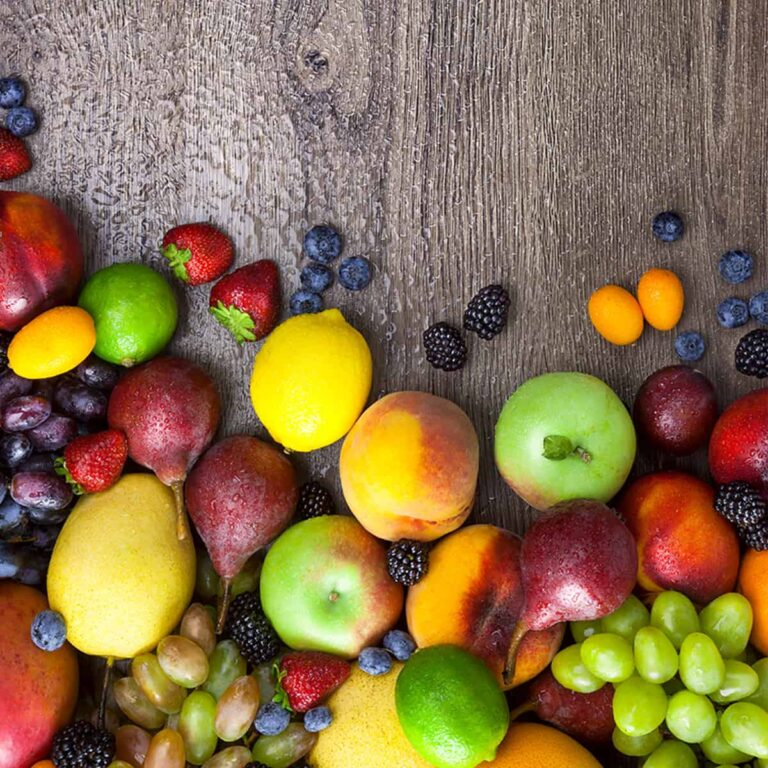 A variety of fruits on a wooden surface