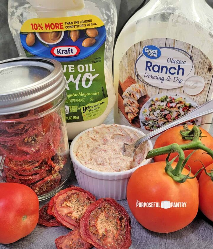 Ingredients for Tomato sandwich spread: Mayo bottle, ranch dressing bottle, jar of dried tomatoes, fresh tomatoes