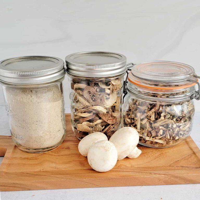 Jars of mushroom powder, dried mushroom slices and dehydrated mushroom chips