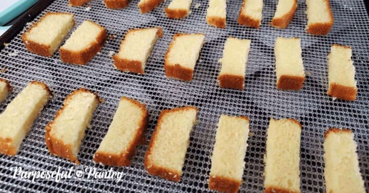 pound cake slices on a dehydrator tray to be dehydrated for diy biscotti